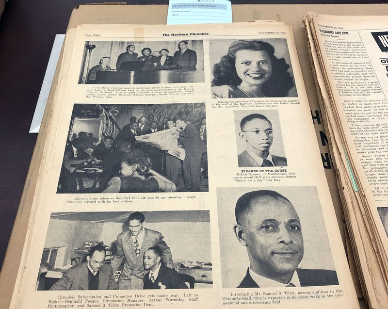 This Nov. 29, 2018, photo shows a Nov. 23, 1946, page highlighting some of the staff of the Hartford Chronicle, a black-owned and operated weekly newspaper in Hartford, Conn. (AP Photo/Susan Haigh)