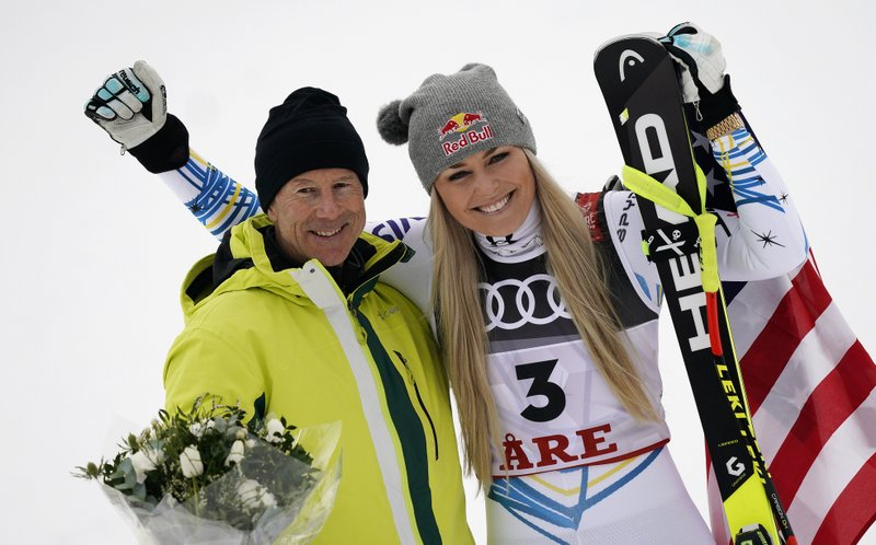 United States' Lindsey Vonn, right, celebrates her third place with Sweden former skier Ingemar Stenmark after the women's downhill race, at the alpine ski World Championships in Are, Sweden, Sunday, Feb. (AP Photo/Giovanni Auletta)