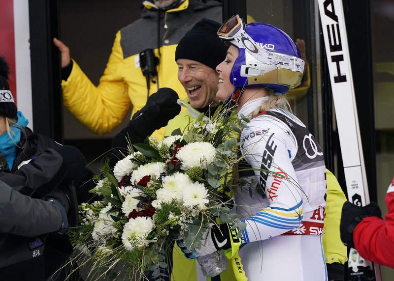 United States' Lindsey Vonn, right, poses with Sweden former skier Ingemar Stenmark in the finish area after the women's downhill race, at the alpine ski World Championships in Are, Sweden, Sunday, Feb. (AP Photo/Giovanni Auletta)
