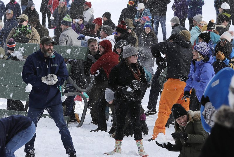Several hundred people take part in a public snowball fight, Saturday, Feb. 9, 2019, at Wright Park in Tacoma, Wash. (AP Photo/Ted S. Warren)