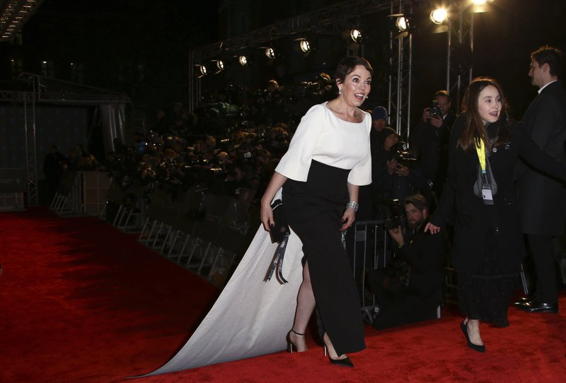 Actress Olivia Colman poses for photographers upon arrival at the BAFTA awards in London, Sunday, Feb. (Photo by Joel C Ryan/Invision/AP)