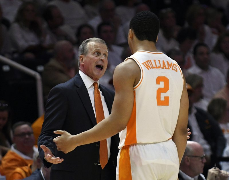 Tennessee head coach Rick Barnes talks to forward Grant Williams (2) as he comes out of the game during the second half of an NCAA college basketball game against Florida, Saturday, Feb. (Joy Kimbrough/The Daily Times via AP)