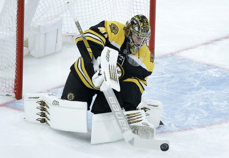 Boston Bruins' Jaroslav Halak, of Slovakia (41) deflects an attempt on goal during the first period of an NHL hockey game against the Colorado Avalanche, Sunday, Feb. (AP Photo/Steven Senne)