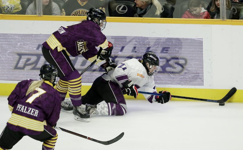 Team Szabados defender Michelle Picard, right, tries to clear the puck past Team Stecklein defender Lee Stecklein, top left, in the NWHL All-Star Hockey Game Sunday, Feb. (AP Photo/Mark Humphrey)