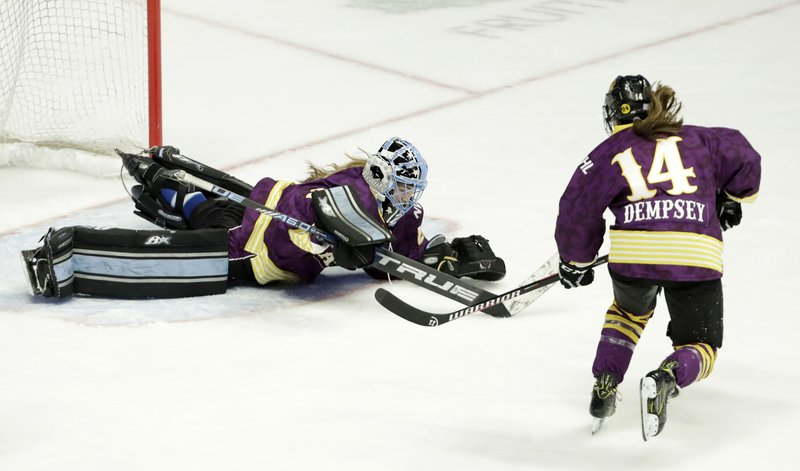 Team Stecklein goalie Nicole Hensley, left, dives on the puck as Jillian Dempsey, right, watches for the rebound in the first period of the NWHL All-Star Hockey Game Sunday, Feb. (AP Photo/Mark Humphrey)