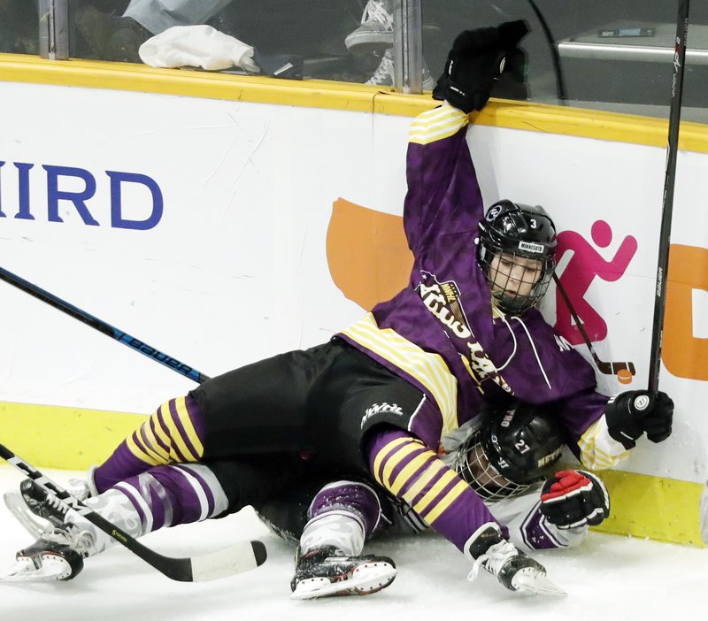Jonna Curtis (3), a forward on Team Stecklein, battles for the puck with Michelle Picard (27), a defender on Team Szabados, during the NWHL All-Star Hockey Game Sunday, Feb. (AP Photo/Mark Humphrey)