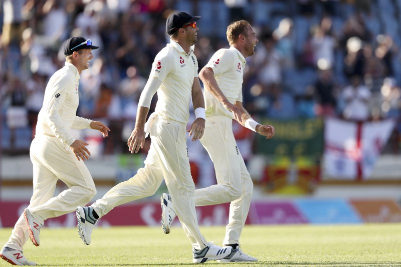 From left to right, England players, Jos Buttler, James Anderson and Stuart Broad celebrate the dismissal of West Indies' Alzarri Joseph during day two of the third cricket Test match at the Daren Sammy Cricket Ground in Gros Islet, St. (AP Photo/Ricardo Mazalan)