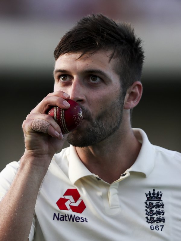 England's Mark Wood kisses the ball as he leaves the field after taking five wickets against West Indies during day two of the third cricket Test match at the Daren Sammy Cricket Ground in Gros Islet, St. (AP Photo/Ricardo Mazalan)