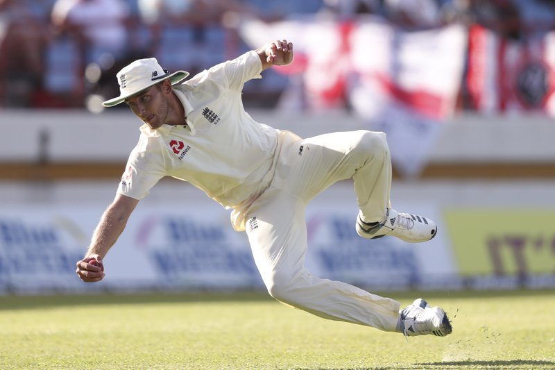 England's Stuart Broad takes the catch to dismiss West Indies' Alzarri Joseph during day two of the third cricket Test match at the Daren Sammy Cricket Ground in Gros Islet, St. (AP Photo/Ricardo Mazalan)