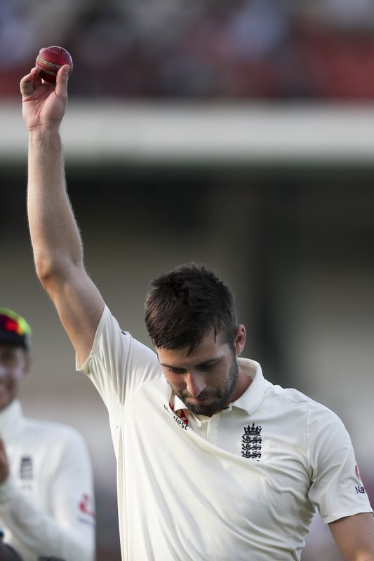 England's Mark Wood raises the ball as he leaves the field after taking five wickets against West Indies during day two of the third cricket Test match at the Daren Sammy Cricket Ground in Gros Islet, St. (AP Photo/Ricardo Mazalan)