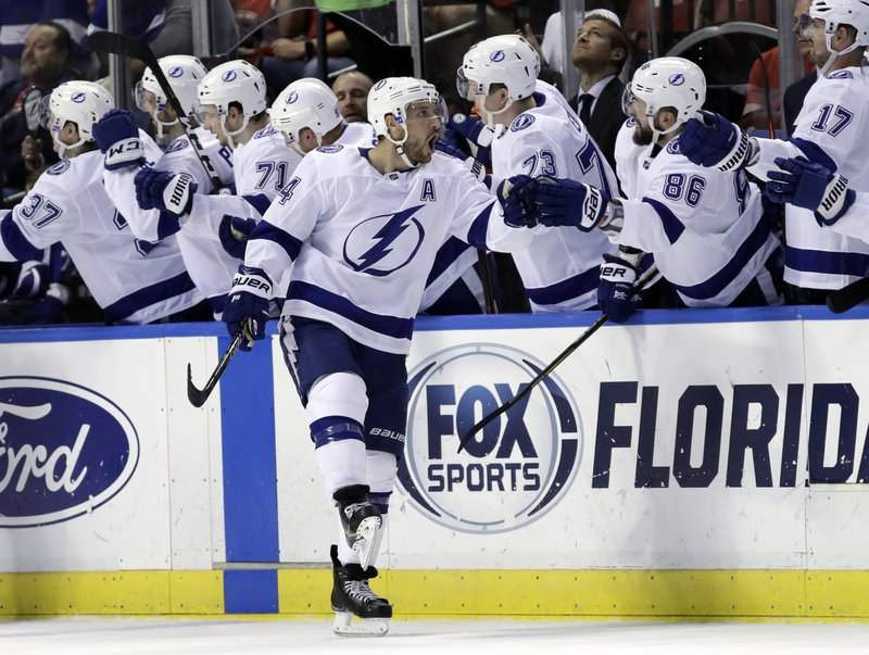 Tampa Bay Lightning right wing Ryan Callahan is congratulated after scoring a goal during the second period of an NHL hockey game against the Florida Panthers, Sunday, Feb. (AP Photo/Lynne Sladky)