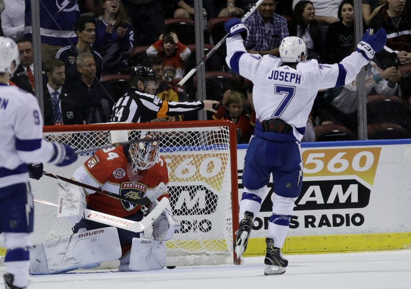 Tampa Bay Lightning right wing Mathieu Joseph (7) celebrates as the puck gets past Florida Panthers goaltender James Reimer (34) on a goal scored by Ryan Callahan during the second period of an NHL hockey game, Sunday, Feb. (AP Photo/Lynne Sladky)