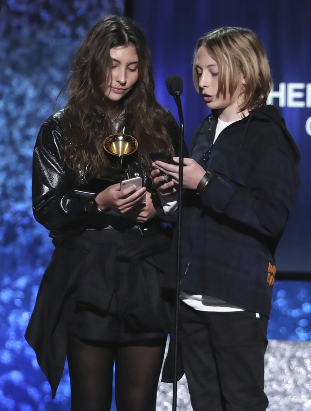 Toni Cornell, left, and Christopher Nicholas Cornell accept the award for best rock performance for