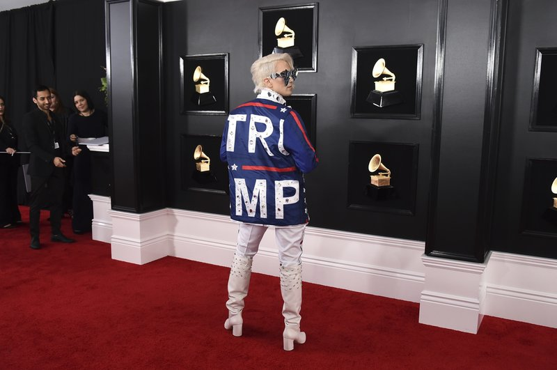 Ricky Rebel arrives at the 61st annual Grammy Awards at the Staples Center wearing a jacket with the word Trump on it, on Sunday, Feb. (Photo by Jordan Strauss/Invision/AP)