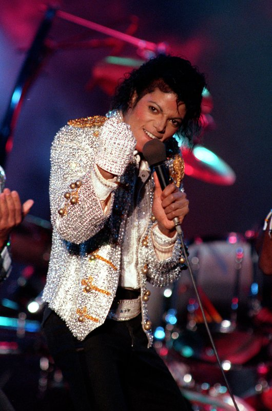FILE - In this Dec. 3, 1984 photo, Michael Jackson performs with his brothers at Dodger Stadium in Los Angeles, as part of their Victory Tour concert. (AP Photo/Doug Pizac, File)
