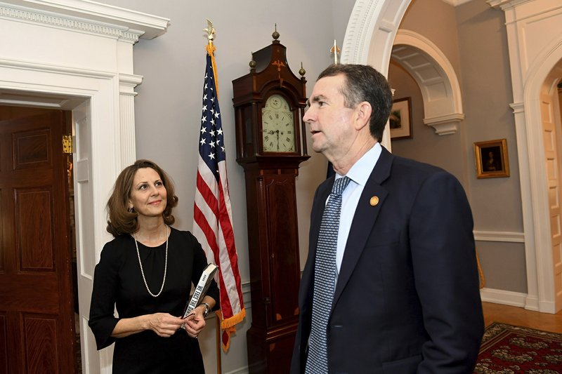 Virginia Gov. Ralph Northam and his wife, Pamela arrive at the Governor's Mansion for an interview, Saturday, Feb. (Katherine Frey/The Washington Post via AP)