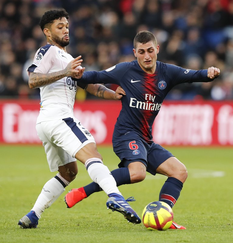 PSG's Marco Verratti, right, and Bordeaux's Otavio challenge for the ball during the French League One soccer match between Paris Saint-Germain and Bordeaux at the Parc des Princes stadium in Paris, Saturday, Feb. (AP Photo/Christophe Ena)