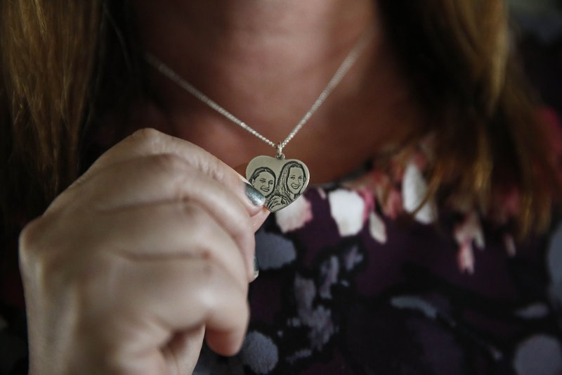 Lori Alhadeff, mother of 14-year-old Alyssa Alhadeff who was one of 17 people killed at Marjory Stoneman Douglas High School, holds a necklace of her and her daughter on Wednesday, Jan. (AP Photo/Brynn Anderson)