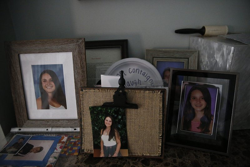 Photographs of 14-year-old Alyssa Alhadeff, one of 17 people killed by a gunman who stalked the halls of Marjory Stoneman Douglas High School, sit on a table in her home on Wednesday, Jan. (AP Photo/Brynn Anderson)