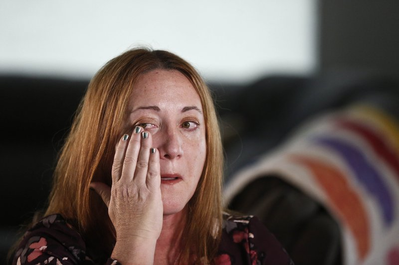 Lori Alhadeff, mother of 14-year-old Alyssa Alhadeff who was one of 17 people killed at Marjory Stoneman Douglas High School, wipes away a tear as she cries while talking about her daughter on Wednesday, Jan. (AP Photo/Brynn Anderson)
