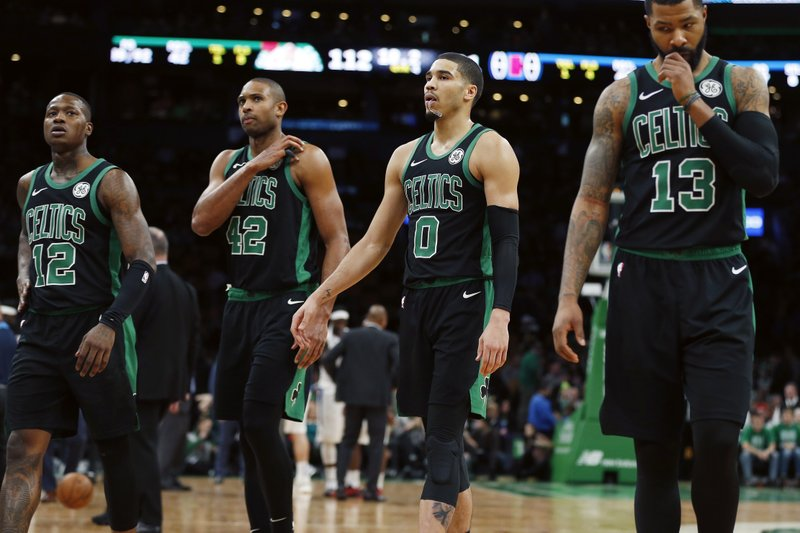 Boston Celtics' Terry Rozier (12), Al Horford (42), Jayson Tatum (0) and Marcus Morris (13) walk to the bench during a timeout in the second half of the team's NBA basketball game against the Los Angeles Clippers in Boston, Saturday, Feb. (AP Photo/Michael Dwyer)