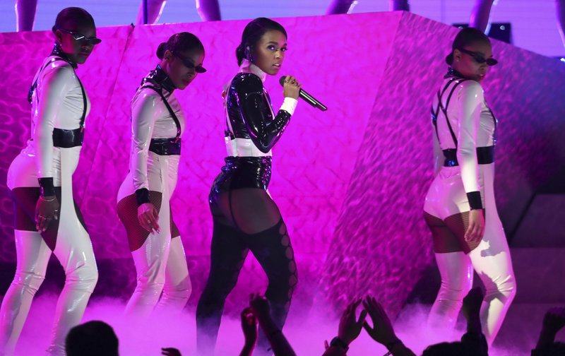 Janelle Monae, center, performs