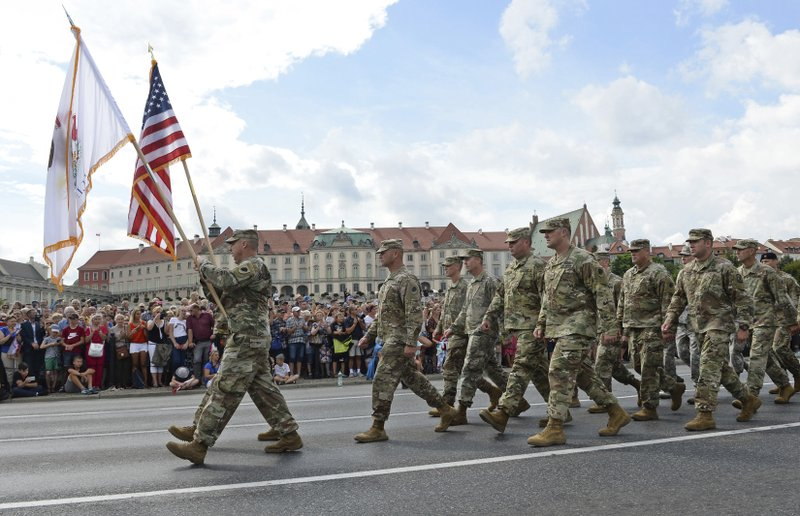 FILE - In this Wednesday, Aug. 15, 2018 file photo, a group of US Army soldiers take part in an annual military parade celebrating Polish Army Day in Warsaw, Poland. (AP Photo/Alik Keplicz, File)