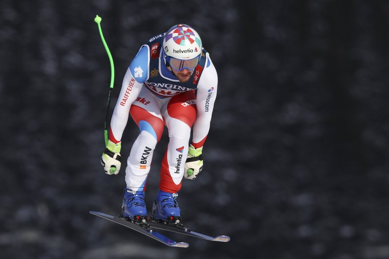 Switzerland's Luca Aerni speeds down the course during the downhill portion of the men's combined, at the alpine ski World Championships in Are, Sweden, Monday, Feb. (AP Photo/Marco Trovati)