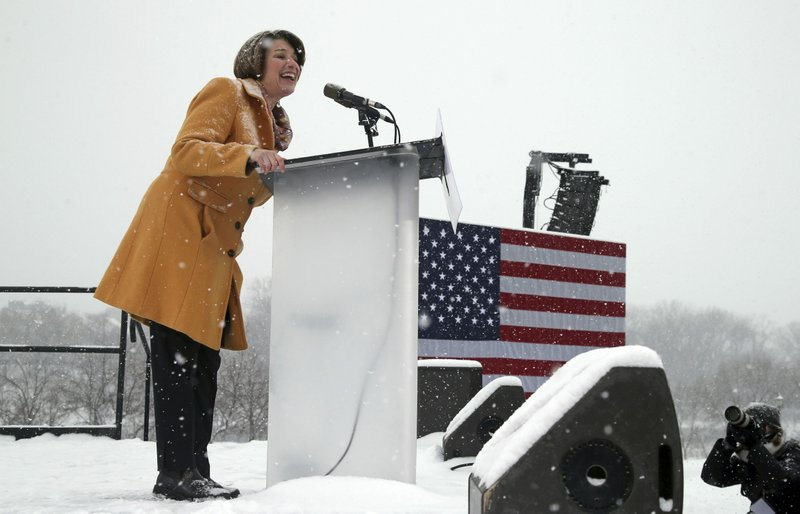 Democratic Sen. Amy Klobuchar addresses a snowy rally where she announced she is entering the race for president Sunday, Feb. (AP Photo/Jim Mone)