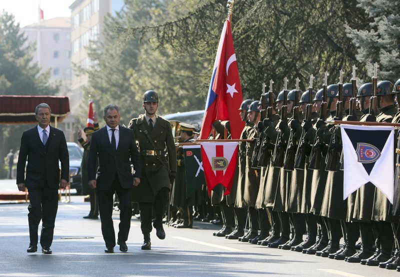 Turkish Defence Minister Hulusi Akar, left, and Russia's Defence Minister Sergei Shoigu inspect a military honour guard before their talks in Ankara, Turkey, Monday, Feb. (Defence Ministry via AP, Pool)