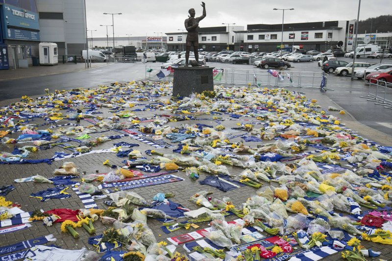 Tributes are placed outside the Cardiff City Stadium, Wales, for Emiliano Sala, Friday Feb. 8, 2019. Tributes are being paid across soccer to Argentine player Emiliano Sala, with the French league announcing a minute's applause before matches. (Aaron Chown/PA via AP)
