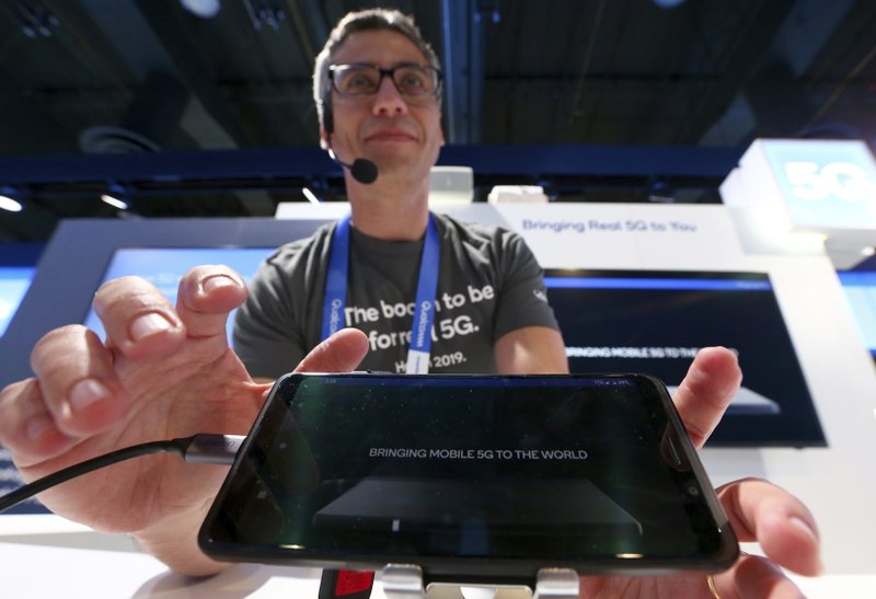 FILE- In this Jan. 9, 2019, file photo Ignacio Contreras, of Qualcomm Technologies, talks about the new Qualcomm 5G platform network at CES International in Las Vegas. (AP Photo/Ross D. Franklin, File)