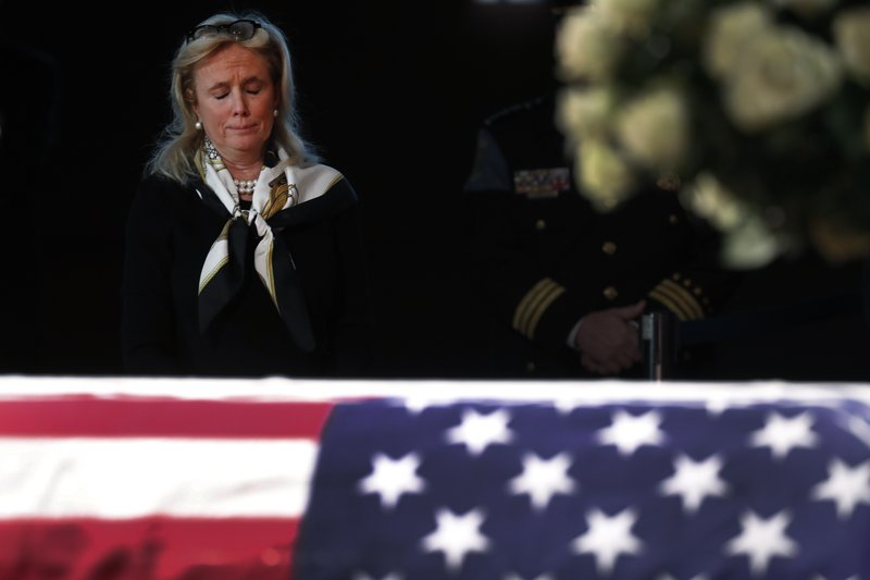 Rep. Debbie Dingell, D-Mich., stands near the casket of her husband and former Rep. John Dingell lying in repose in Dearborn, Mich. (AP Photo/Paul Sancya)
