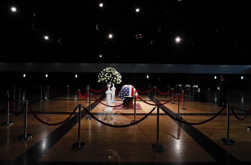 The casket of former Michigan Rep. John Dingell, lies in repose in Dearborn, Mich., Monday, Feb. 11, 2019. (AP Photo/Paul Sancya)