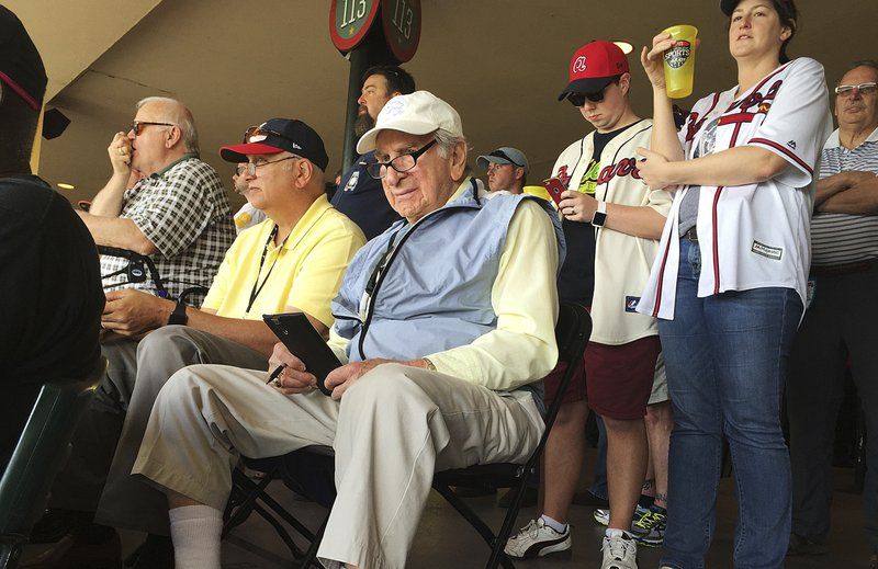 FILE - In this March 5, 2016, file photo, Tommy Giordano, special assistant to the general manager of the Atlanta Braves, scouts a spring training baseball game between the Braves and the Pittsburgh Pirates, in Kissimmee, Fla. (AP Photo/Paul Newberry, File)