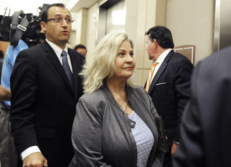 FILE - In this April 29, 2016, file photo, Sandra Merritt is surrounded by her attorneys as she leaves a courtroom after a hearing in Houston. (AP Photo/Pat Sullivan, File)