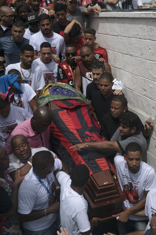 Friends and relatives carry the coffin that contain the remains of Samuel de Souza Rosa, one of the 10 young soccer players killed in a fire at the training ground of Brazilian soccer club Flamengo, during his funeral in Sao Joao de Meriti, Brazil, Monday, Feb. (AP Photo/Leo Correa)