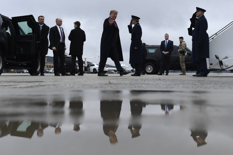 President Donald Trump waves as he arrives to board Air Force One at Andrews Air Force Base in Md., Monday, Feb. (AP Photo/Susan Walsh)