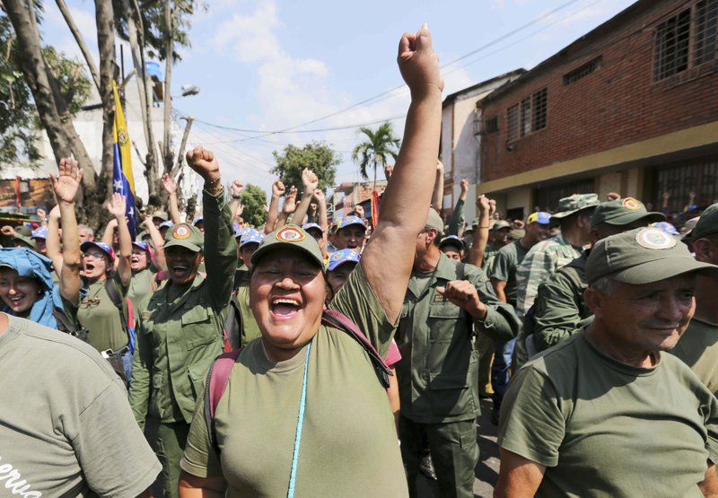 Members of Venezuela's Bolivarian Militia cheer for Diosdado Cabello, president of the Constitutional Assembly during a rally in Urena, Venezuela, Monday, Feb. (AP Photo/Fernando Llano)