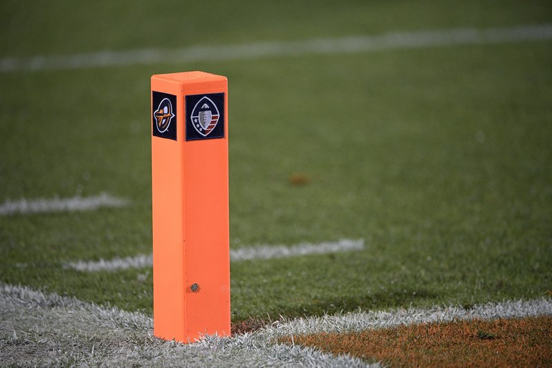 Logos for the Alliance of American Football, right, and the Orlando Apollos adorn an end zone pylon before an AAF football game between the Apollos and the Atlanta Legends on Saturday, Feb. (AP Photo/Phelan M. Ebenhack)