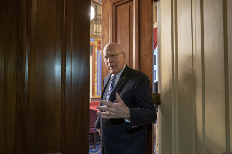 Sen. Patrick Leahy, D-Vt., the ranking member of the Senate Appropriations Committee, enters a closed meeting room at the Capitol as bipartisan House and Senate bargainers trying to negotiate a border security compromise in hope of avoiding another government shutdown, in in Washington, Monday, Feb. (AP Photo/J. Scott Applewhite)