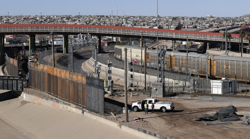In this Tuesday, Jan. 22, 2019, photo, a new barrier is built along the Texas-Mexico border near downtown El Paso. (AP Photo/Eric Gay)