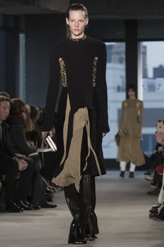 Fashion from the Proenza Schouler collection is modeled during New York Fashion Week, Monday, Feb. 11, 2019. (AP Photo/Mary Altaffer)