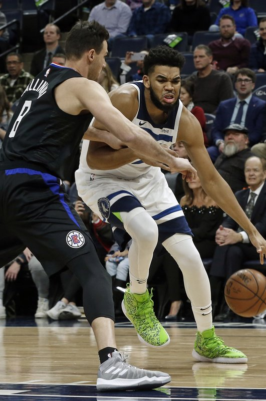 Minnesota Timberwolves' Karl-Anthony Towns, right, tries to work around Los Angeles Clippers' Danilo Gallinari in the first half of an NBA basketball game Monday, Feb. (AP Photo/Jim Mone)