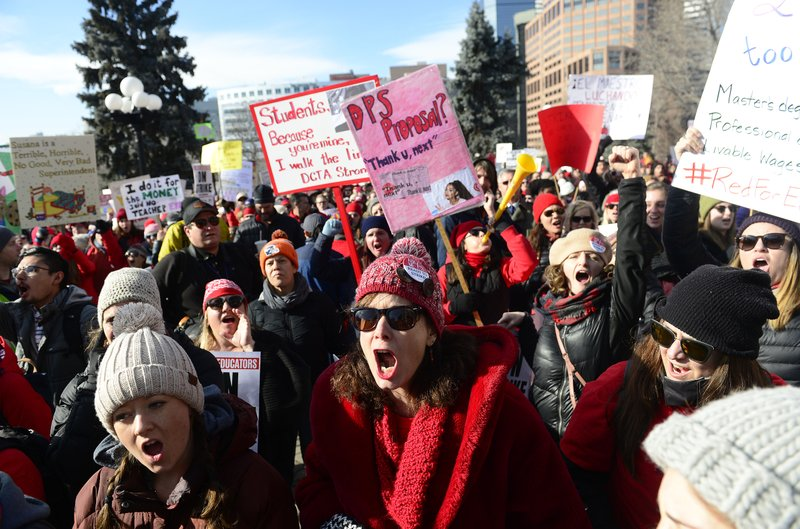 Lori Gates, center, a 3rd grade teacher from Park Hill elementary school, shouts with other teachers during a strike rally on the west steps of the state Capitol on the first day of the Denver Public Schools Teacher's strike, Monday, Feb. (Helen H. Richardson/The Denver Post via AP)