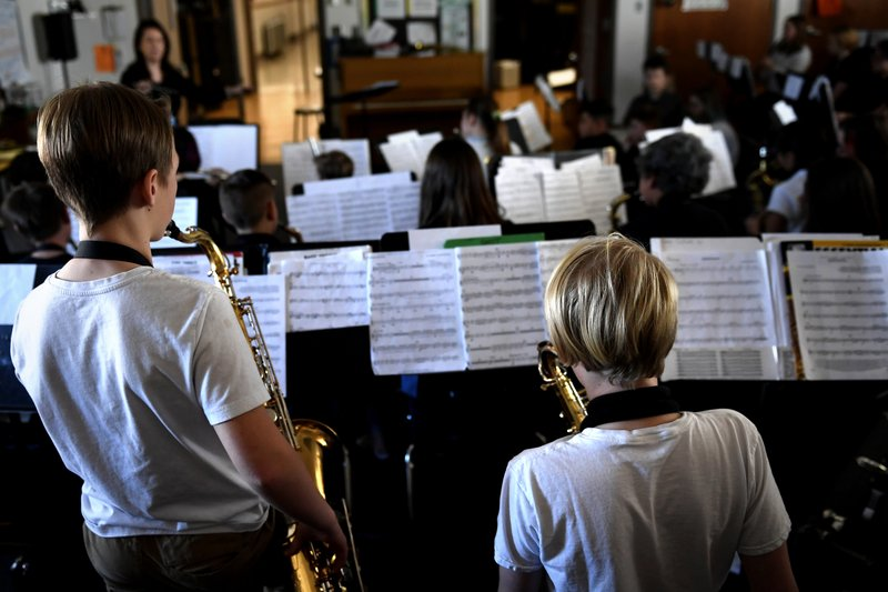 Students in a combined beginner and concert band class work on their music taught by Michelle Koyama, executive principle of Skinner and Lake Middle Schools, at the school during the first day of the Denver Public Schools teachers strike, Monday, Feb. (Joe Amon/The Denver Post via AP)