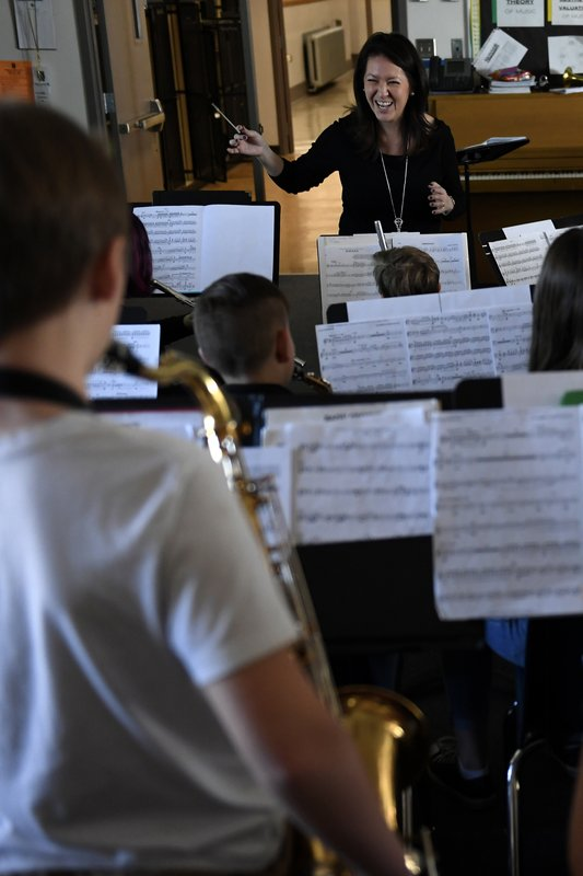Michelle Koyama, executive principle of Skinner and Lake Middle Schools, teaches a mix of the beginner and concert bands at the school during the first day of the Denver Public Schools teachers strike, Monday, Feb. (Joe Amon/The Denver Post via AP)