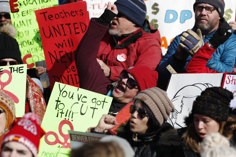 Teachers chant in support during a strike rally on the west steps of the State Capitol Monday, Feb. 11, 2019, in Denver. (AP Photo/David Zalubowski)