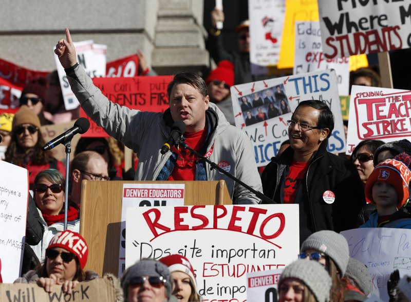 Rob Gould, center left, a special education teacher and lead Denver Classroom Teachers Association negotiator, and Henry Roman, center right, president of the teachers union, speak to teachers during a strike rally on the west steps of the State Capitol Monday, Feb. (AP Photo/David Zalubowski)