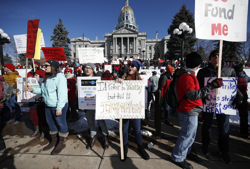 Angela Jenners, center, a teacher at Bear Valley International School, leads fellow picketers in a chant during a strike rally in front of the state Capitol, Monday, Feb. (AP Photo/David Zalubowski)